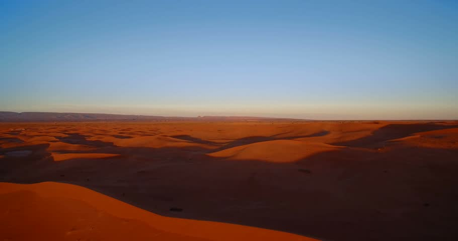 Aerial, Sahara Sunset, Erg Chegaga, Morocco - Graded and stabilized version. Watch also for the native material, straight out of the camera. | Shutterstock HD Video #23169118