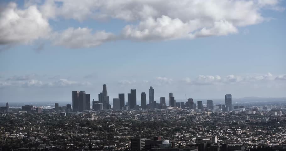 A time lapse shot from above looking at Los Angeles downtown skyline by noon with clouds passig quickly  | Shutterstock HD Video #23172232