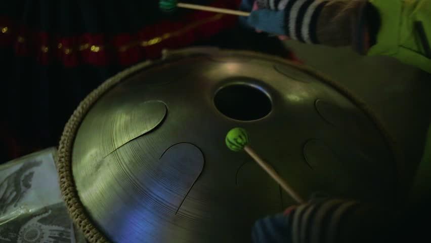 Hands girl playing Hang | Shutterstock HD Video #23179909