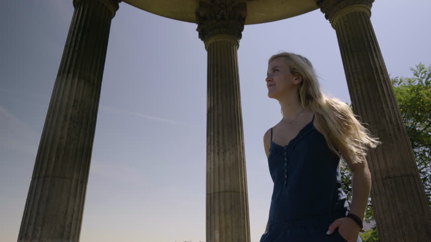AaBeautiful Young Woman Enjoys The Sights From The Temple De La Sibylle In The Parc Des Butte Chaumont In Paris, France | Shutterstock HD Video #23180881