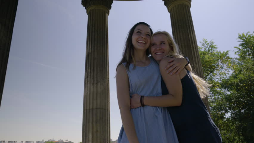 Young Women Tourists Hug With Excitement In The Temple De La Sibylle In The Parc Des Butte Chaumont In Paris, France | Shutterstock HD Video #23180890