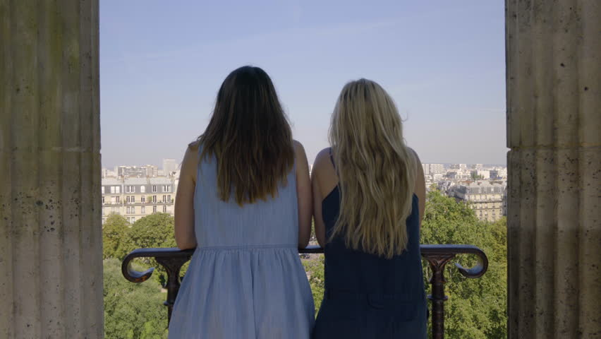Young Women Chat And Enjoy The View From The Temple De La Sibylle In The Parc Des Butte Chaumont In Paris, France | Shutterstock HD Video #23180899