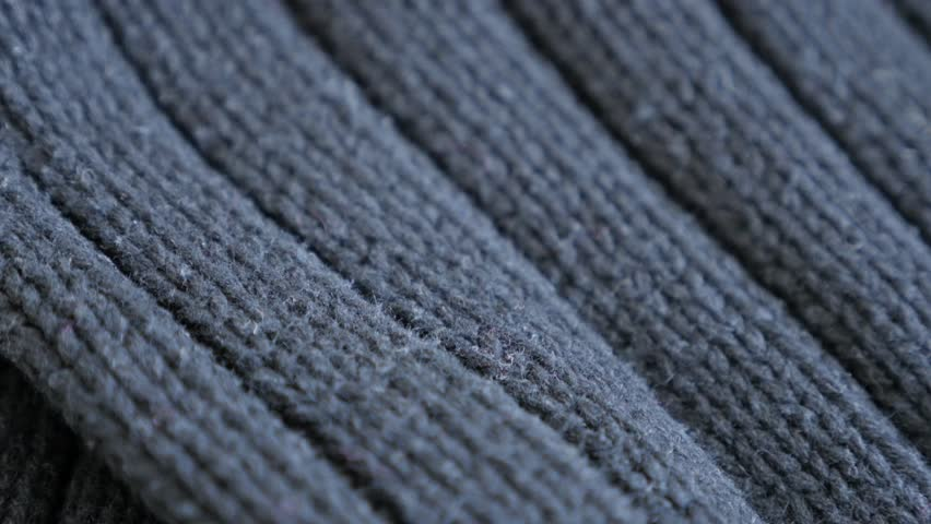 Wool gray sweater details and knitwork 4K 2160p 30fps UltraHD tilting footage - Ribbing or stockinette stitch knitting work slow tilt 3840X2160 UHD video   Shutterstock HD Video #23186488
