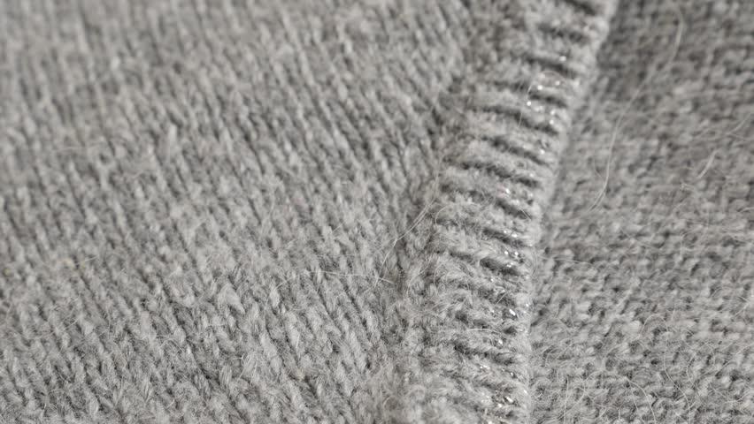 Close-up of  modern hairy women sweater knitting texture 4K 2160p 30fps UltraHD  footage - Shallow DOF fashion gray knitwork 3840X2160 UHD tilting video   Shutterstock HD Video #23191330