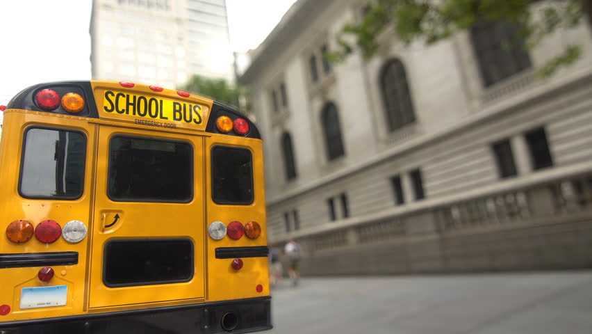 Yellow School Bus parked on a New York City street in front of the public library building   Shutterstock HD Video #23199835
