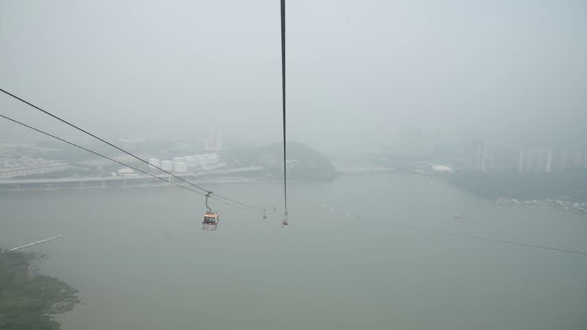 Ngong Ping 360 cable car on Lantau Island, Hong Kong. Cable car to mountain.   Shutterstock HD Video #23204101