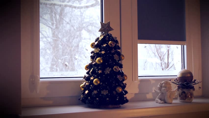 Christmas time, Christmas tree, snow falling outside the window. | Shutterstock HD Video #23207287