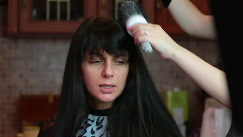 Drying and combing of hair. hairdresser dries the hair and put the customer | Shutterstock HD Video #23210923