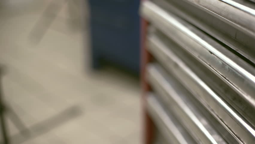 Male hand pushes one of the metal tool boxes and takes the key. | Shutterstock HD Video #23212300