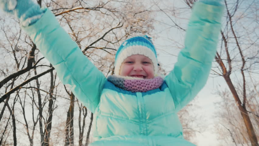 Cheerful little girl goes on a sled, claps his hands, is happy winter | Shutterstock HD Video #23283382