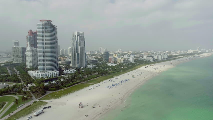 South Beach Miami Aerial Shot of Skyline Buildings and Long View of White Sand Vacation  Destination | Shutterstock HD Video #23296891