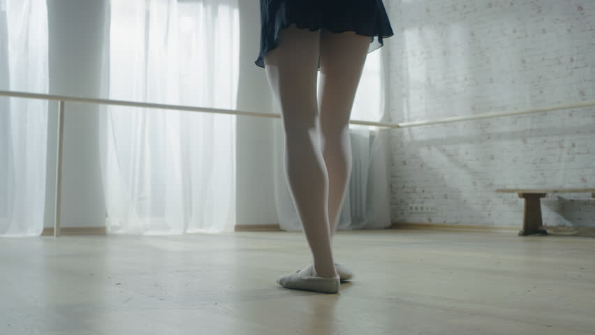 Close shot of Ballerina's Legs. She Does Stretching and Warm up Routine in the Morning. Shot in a Spacious and Modern Studio.  Shot on RED EPIC-W 8K Helium Cinema Camera. | Shutterstock HD Video #23340883