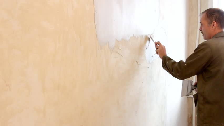 Man plastering wall with spatula. | Shutterstock HD Video #23382238