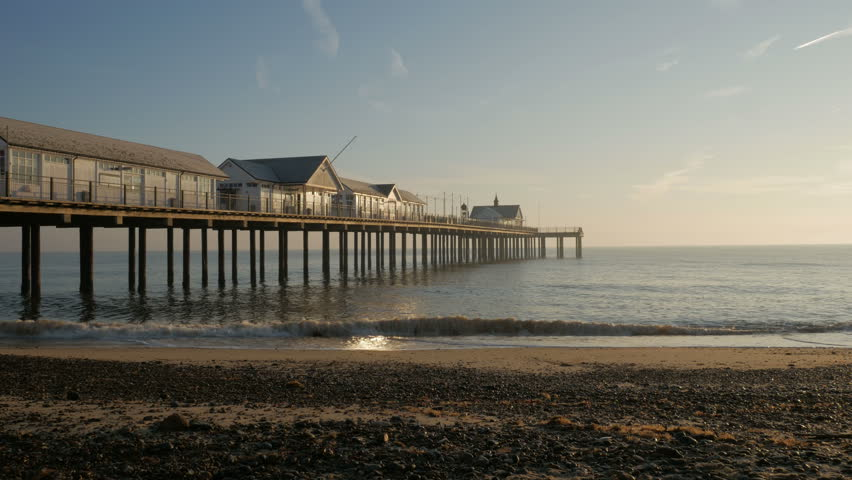 Southwold, England - January 2017. Sunrise, early morning light on Southwold Pier and Beach, Southwold, Suffolk, England, United Kingdom | Shutterstock HD Video #23385505
