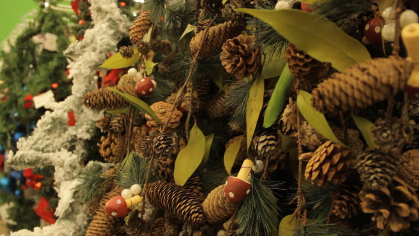 Christmas tree with brown toys and decorations background. Close-up. In the hypermarket. #23435266