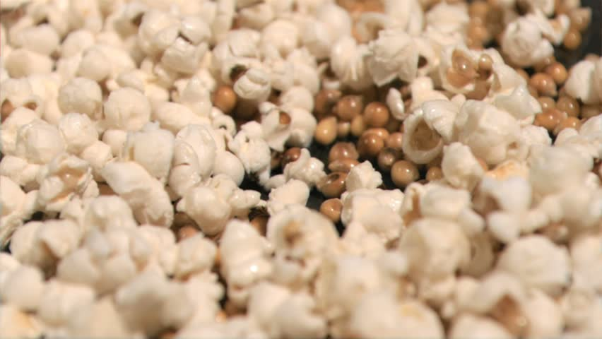 Popcorn cooking in super slow motion on a pan in close-up - HD stock footage clip