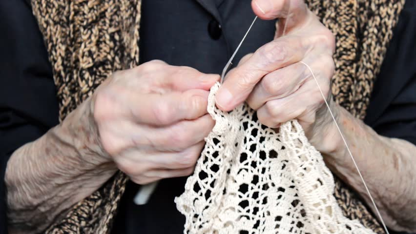 Old Knitting Woman : Close up of hands an elderly woman knitting a blue