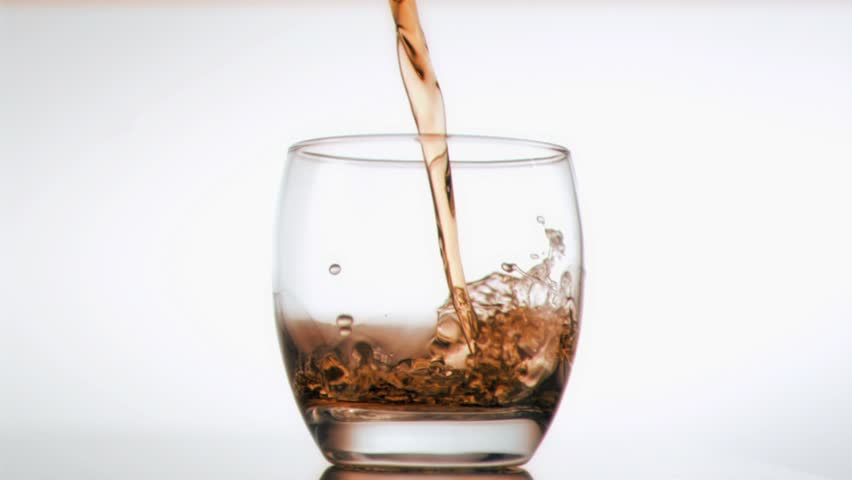 Ice and whiskey been poured in super slow motion against a white background - HD stock footage clip