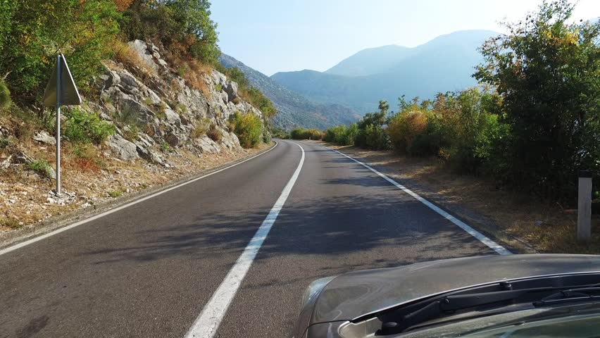 Driving in the car on the mountain road outside window view   Shutterstock HD Video #23969308