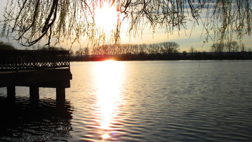 timelapse sunset at city lake in spring