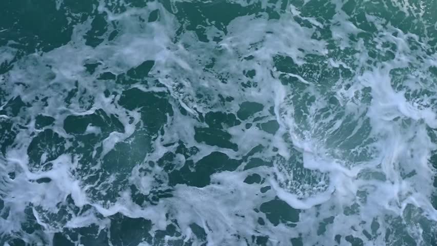 Aerial view footage of ocean waves crashing.   Shutterstock HD Video #24066697