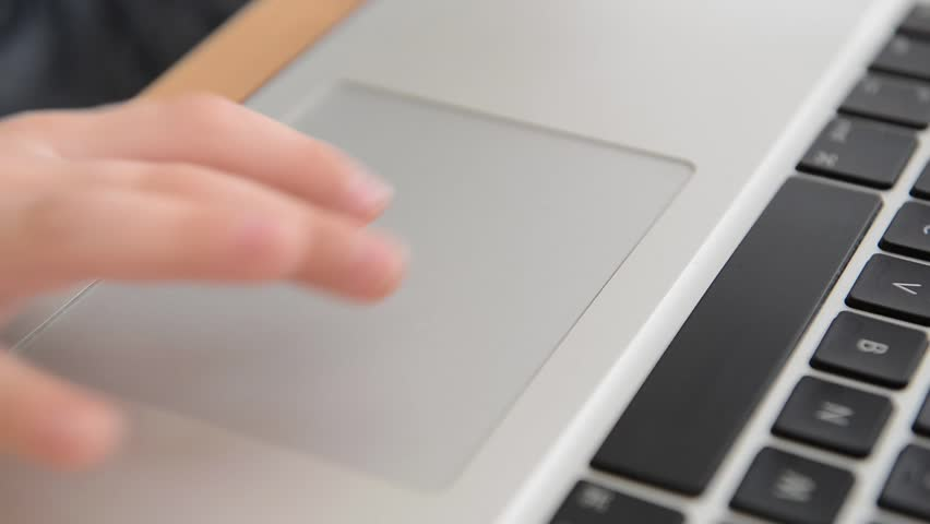 Smart child plays with his fingers on the laptop in educational games | Shutterstock HD Video #24075040