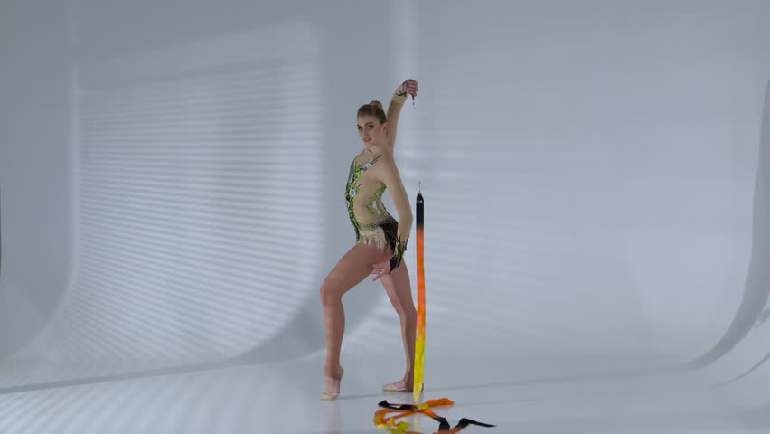 Gymnast circle around yourself with the tape in the hands. White background | Shutterstock HD Video #24098044