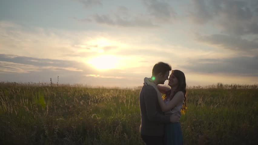 Couple hugging in a field. | Shutterstock HD Video #24102679