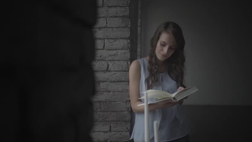 Man embraces girl reading a book. | Shutterstock HD Video #24102742