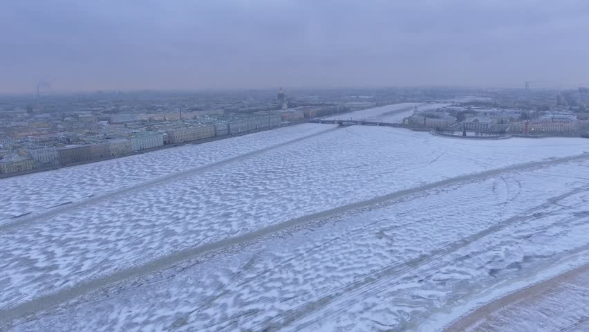 St.Petersburg Russia. Neva River covered in ice and snow. Winter day, dramatic mood. Unique cinematic 4k drone footage. Accent and drift. City panorama. Aerial | Shutterstock HD Video #24106837