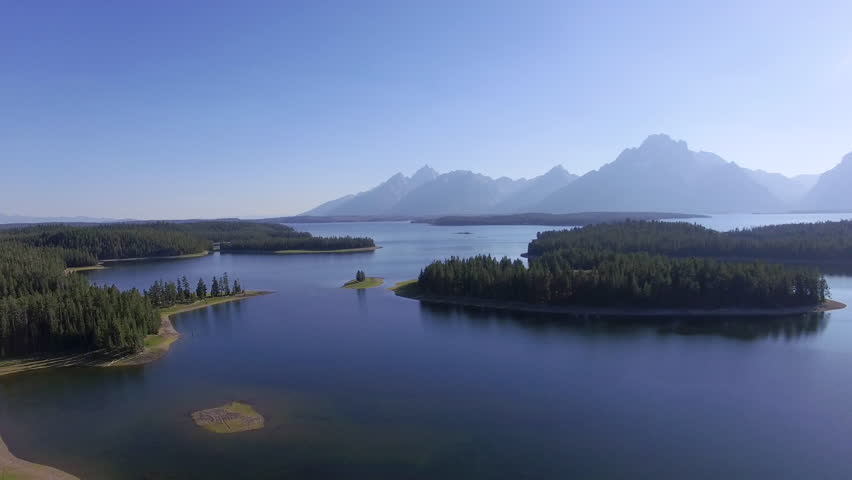 Above Jackson Lake the camera flies backwards to reveal more of the environment | Shutterstock HD Video #24108178