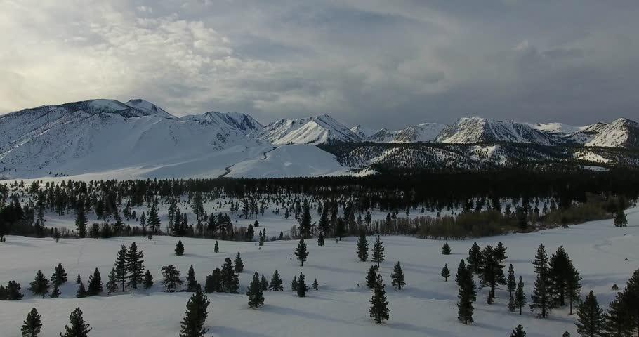 Aerial pullback shot of a snowy valley 4k 24fps | Shutterstock HD Video #24115711