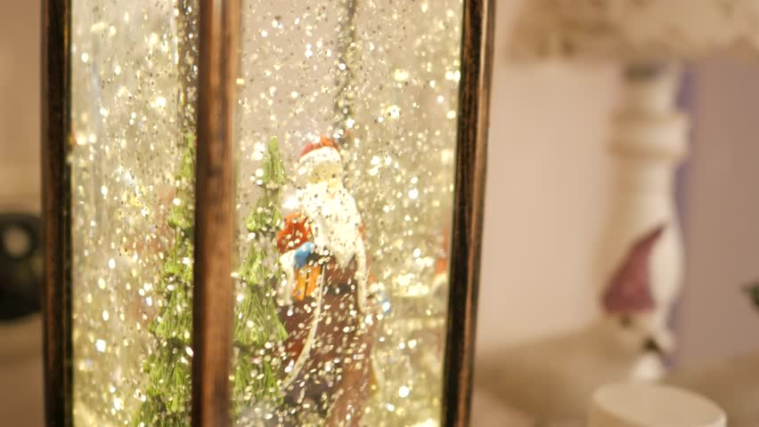Santa Claus and Xmas tree in a snow dome with bright sparkles. Handheld shot | Shutterstock HD Video #24117412