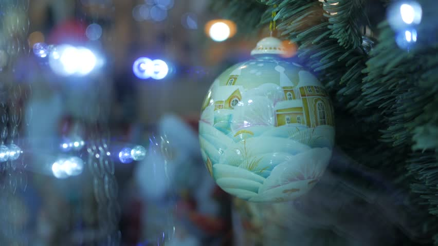 Christmas decorations through a window with reflection of garland lights | Shutterstock HD Video #24117430