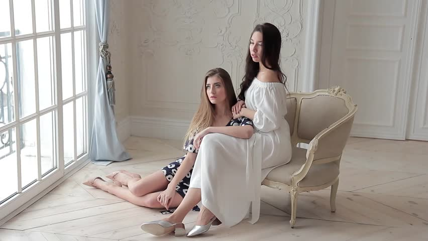 Two romantic fashion models posing sitting on chair in beaytiful interior   Shutterstock HD Video #24122668