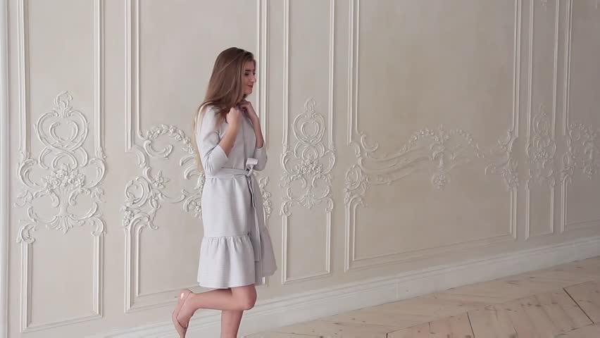 Romantic fashion model posing in dress in studio   Shutterstock HD Video #24122695