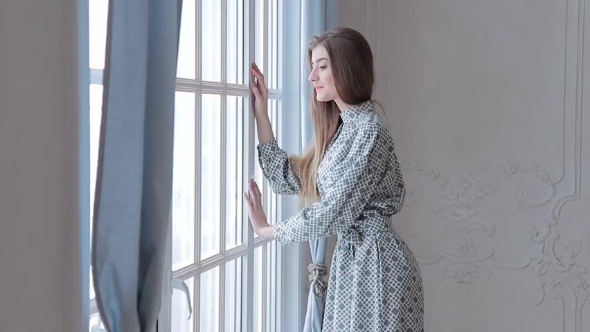 Fashion caucasian model posing near window   Shutterstock HD Video #24122704