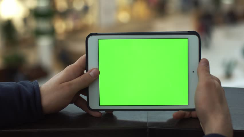 Male hands using tablet with green screen in shopping mall. Lot of people at the background | Shutterstock HD Video #24124504