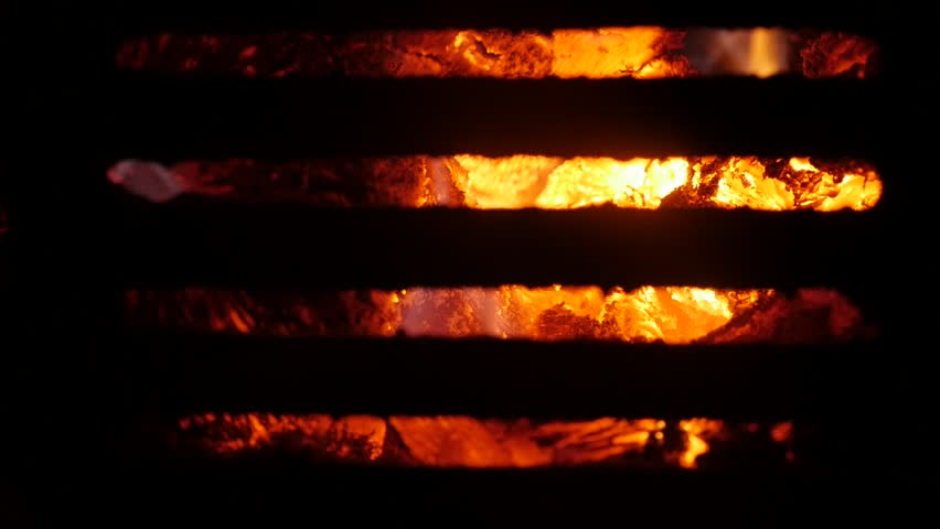 Slow motion flame spreading around burned logs  | Shutterstock HD Video #24126979