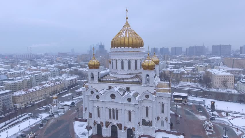 Beautiful Cathedral of Christ the Saviour Unique aerial drone flight around. Snow winter weather. White snow golden domes. To cross. day. | Shutterstock HD Video #24127276