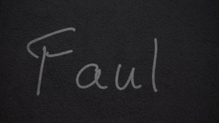 "Handwritten word ""Fault"" on a wall 