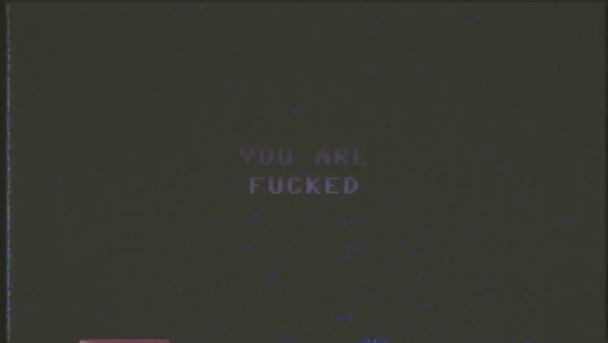 A fake VHS screen showing the text Game over - You are fucked. 8 bit retro style.  | Shutterstock HD Video #24131218
