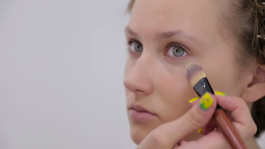 Professional make-up artist applying cream base eyeshadow primer to model eye. Beauty, makeup and fashion concept   Shutterstock HD Video #24132091