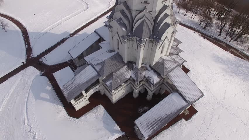 Beautiful Russian winter landscape. White old Kremlin In Kolomenskoe Moscow. Frozen winter river snow. Unique aerial drone flight over from above. Sunny day. Park. Cinematic 4K. From Close to distant | Shutterstock HD Video #24132154