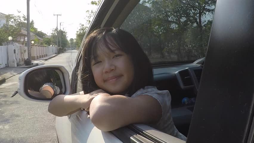 Happy Asian girl travels by car, slow motion   Shutterstock HD Video #24133180