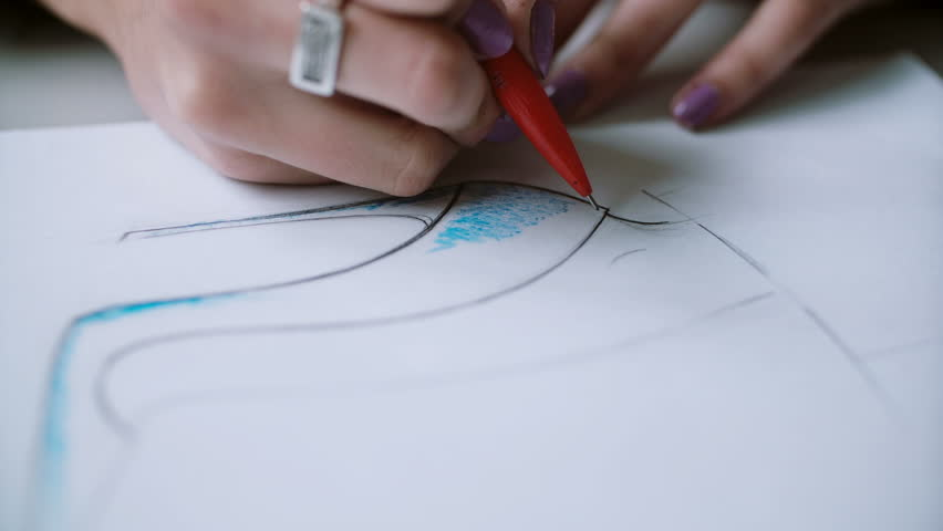 Close-up view of layout of woman s shoes drawing by young designer. Woman developing new collection. 4K | Shutterstock HD Video #24141667