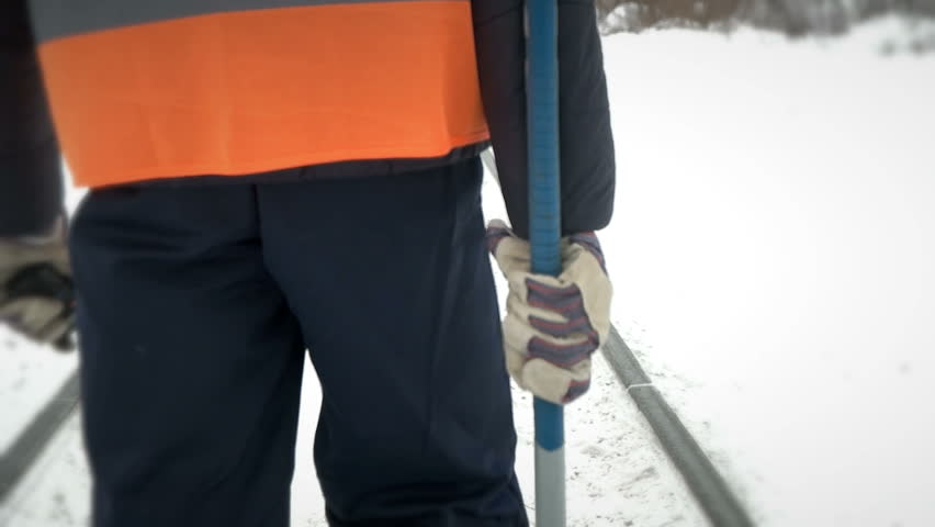 Worker with a sledgehammer goes along the railway | Shutterstock HD Video #24143971