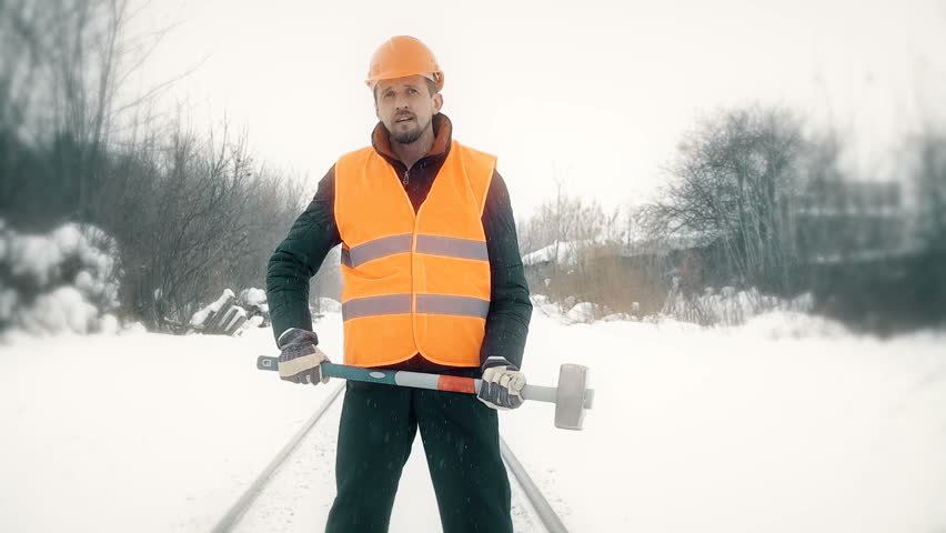 Worker with a sledgehammer goes along the railway | Shutterstock HD Video #24144313