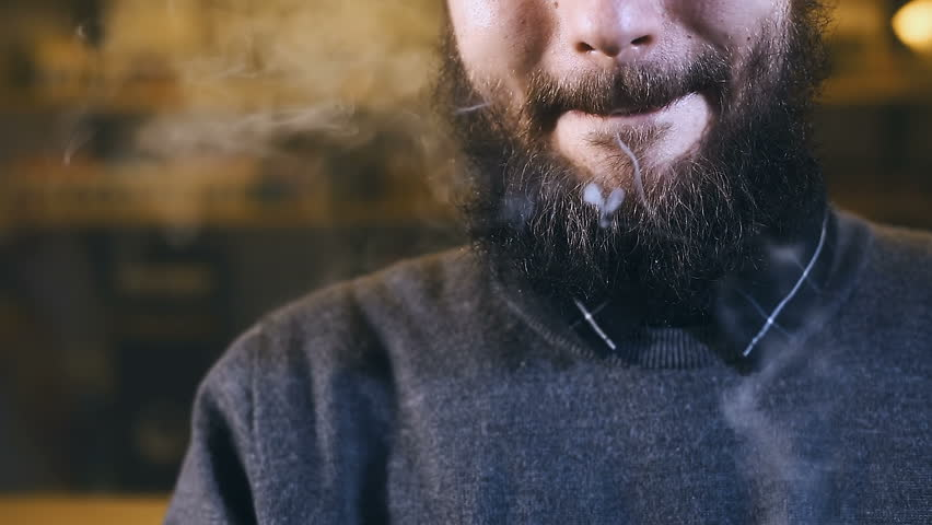 Man smoking electronic cigarette vapor | Shutterstock HD Video #24155059