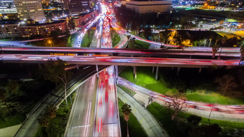 4K Static Aerolapse ( timelapse / hyperlapse ) view of huge traffic on freeway interchange of 110 and 101 freeways in downtown Los Angeles. | Shutterstock HD Video #24213568